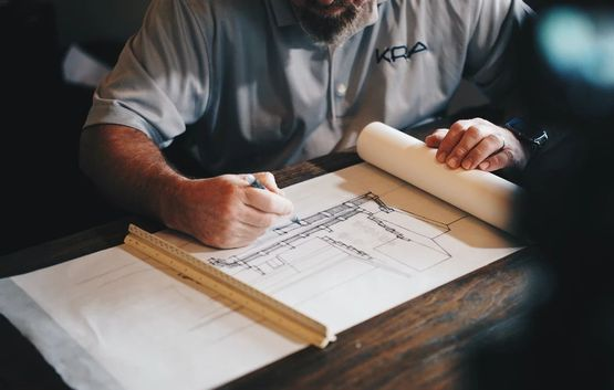 man making a construction plan